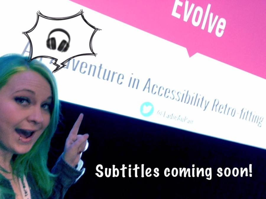 "Tara pointing at her presentation with the caption ""Subtitles coming soon"""